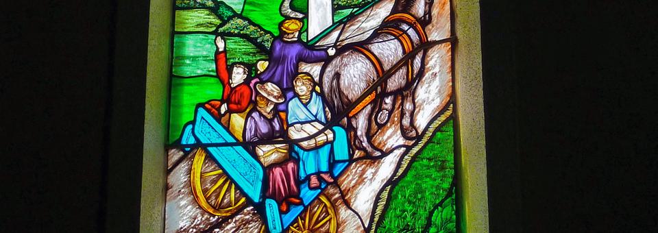 Emigration stained glass window in St. Patrick's Church, Addergoole, Ireland
