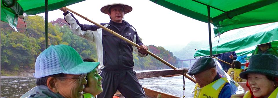 longboat in the white water of the Arakawa River gorge in Nagatoro's Chichibu-Tama National Park
