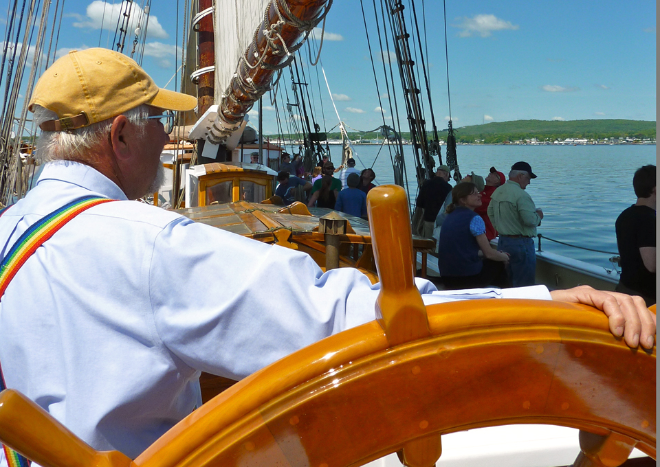 Captain Doug at the helm of the schooner Heritage, Rockland, Maine