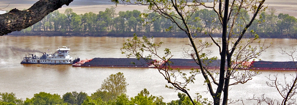 view of a coal-filled barge on the Ohio River from Blue Heron Winery, Cannelton, Indiana