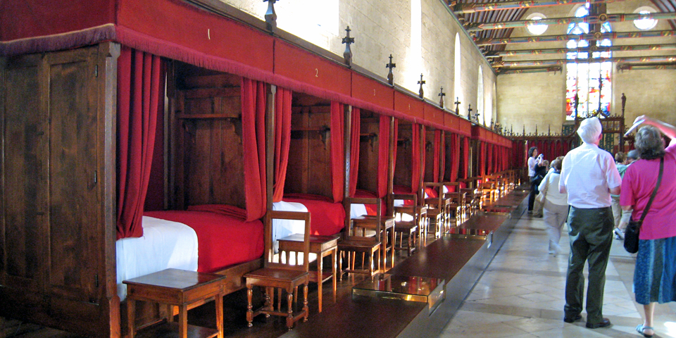 Hôtel Dieu, Beaune, a hospice built to treat the famine and disease brought by the Hundred Year's War. Beds were once shared without regard to gender.