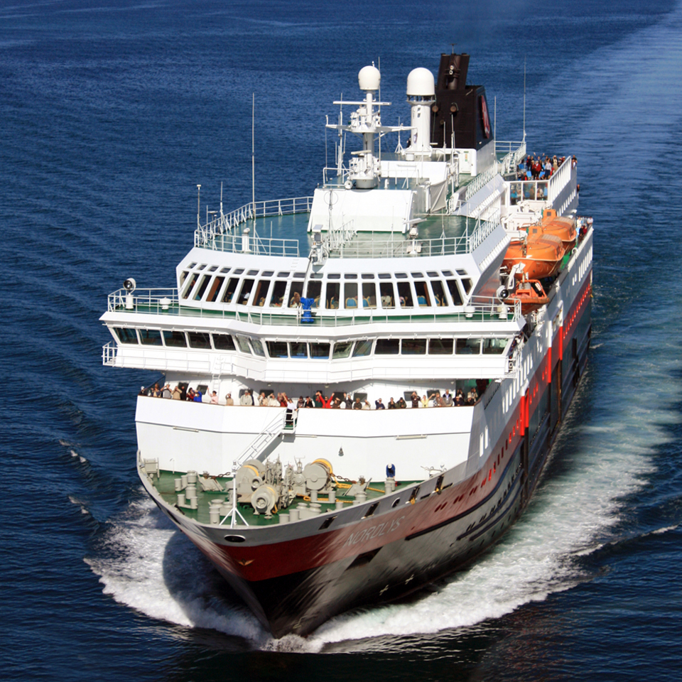 Hurtigruten's Nordlys is shown here approaching the Blue City, Sortland, named for the color of its downtown buildings,