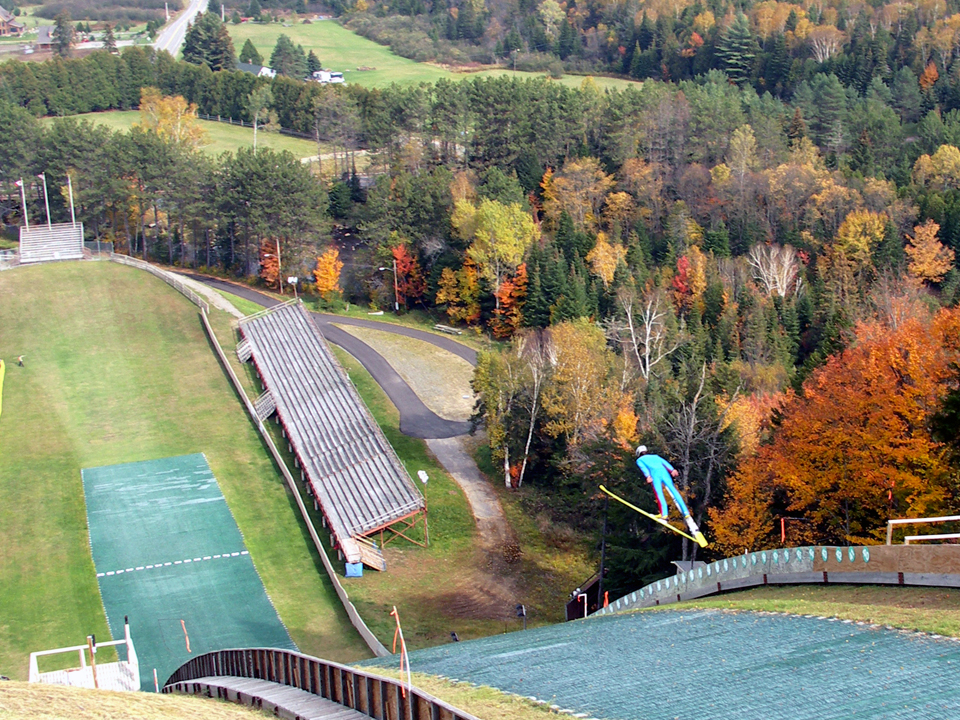Watch athletes as they soar through the air at the Olympic Ski Jumping Complex.