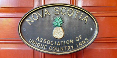 Association of Unique Country Inns sign