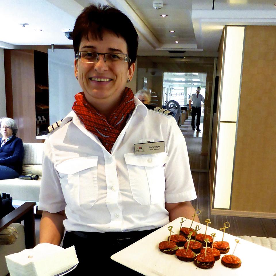 Hotel Manager Doris with canapés of Hungarian sausages.