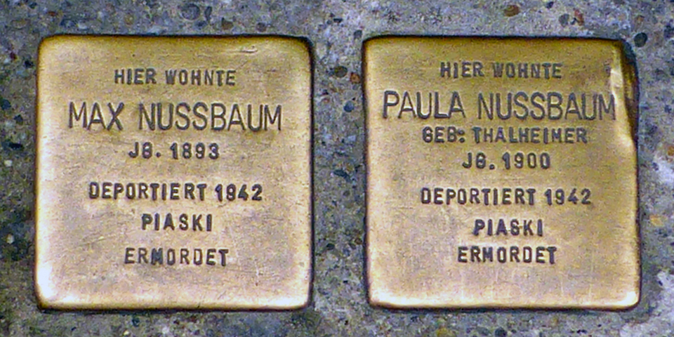 Plaques in sidewalks denoting former homes of Jewish people who were victims of the Holocost
