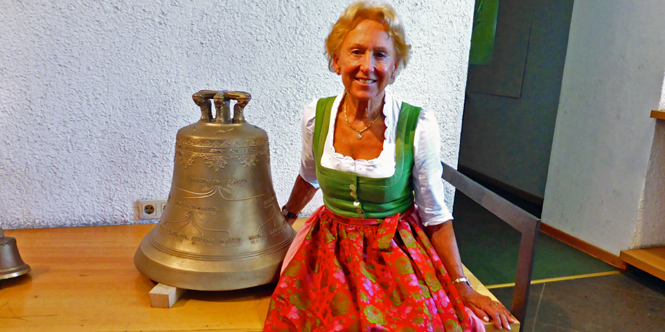 Elisabeth Grassmayr with a bell decorated with her family tree at the Grassmayr Bell Foundry, Innsbruck, Austria
