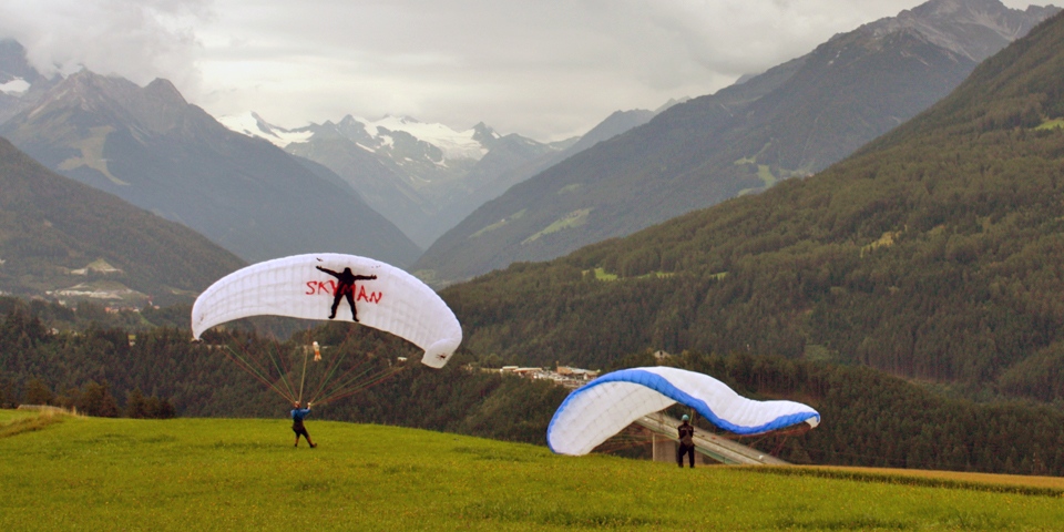 paragliders in the mountains above Innsbruck, Austria