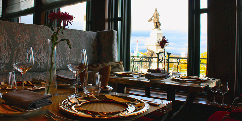 view of Samuel de Champlain statue from the Champlain dining room of the Fairmont Le Château Frontenac, Quebec City