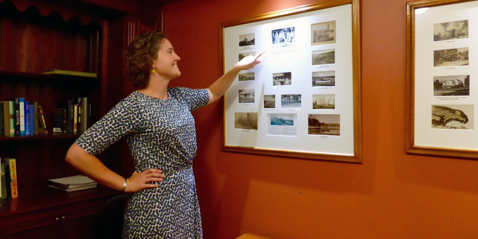 Fifth generation host Sarah Morris with favorite generational photos at the Basin Harbor Club, Vergennes, Vermont
