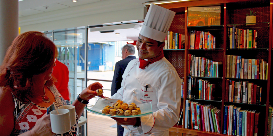 Viking Magni's Chef George Pereira with a sweet treat as passengers return from an excursion