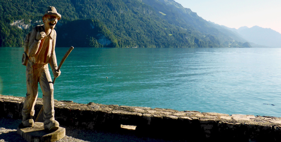 hiker along the lakeeside promenade in Brienz