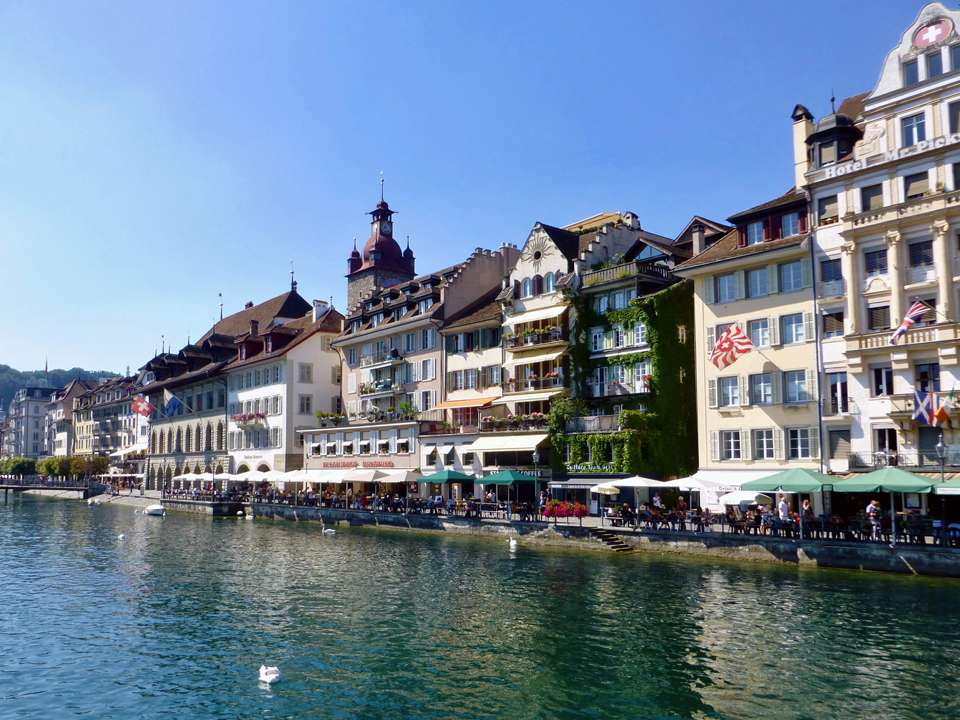 A row of restaurants in 17th century houses line the Reuss River in Lucerne.