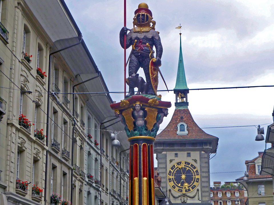 zahringerbrunne, the bear in full armor, and the medieval clock tower on Kramgasse, Bern, Switzerland