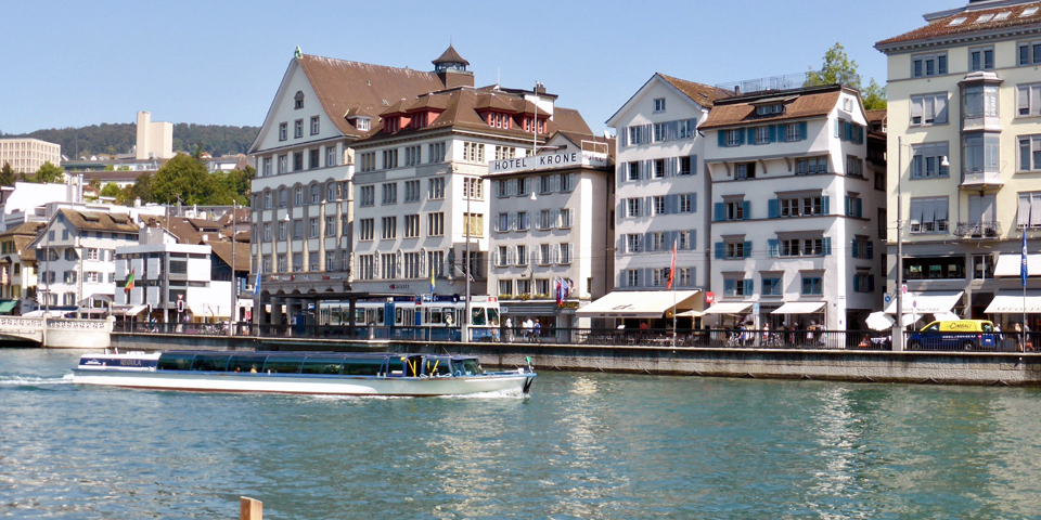 Tram and river taxi, Limmat River, Zurich