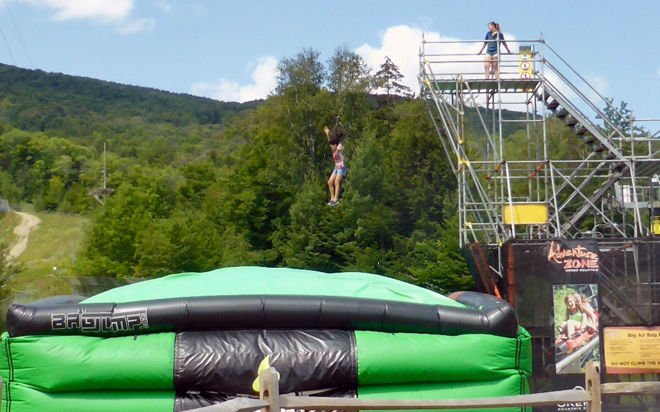 Jump into the AMP Energy Big Air Bag at the Adventure Zone at Okemo Mountain Resort