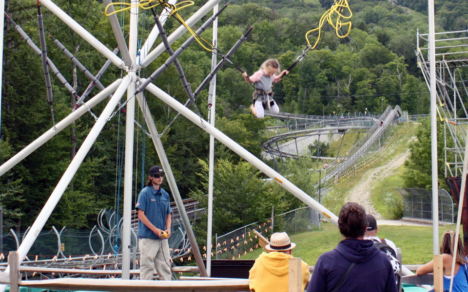 Bungee jump on a trampoline at the Adventure Zone of Okemo Mountain Resort