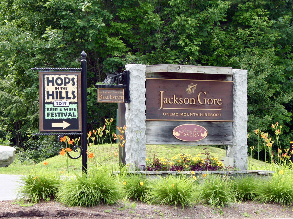 Hops in the Hills signs, Jackson Gore Inn courtyard, Okemo Mountain Resort, Vermont