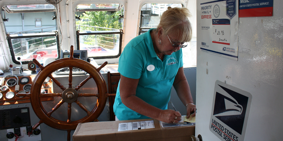 The postmistress in the mail boat M/V Sophie C.