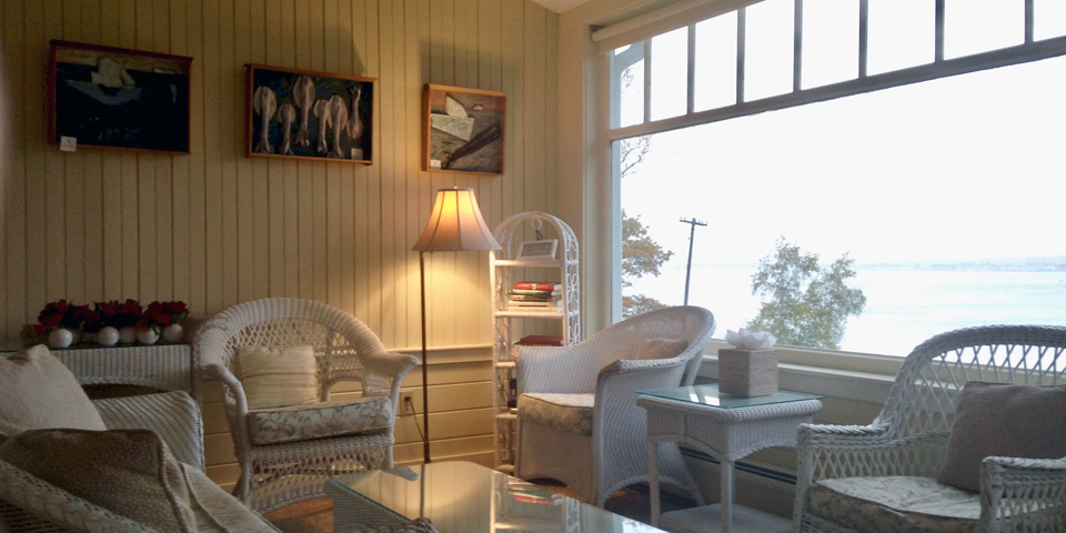 one of the sitting areas in the sunroom, Black Point Inn, Scarborough, Maine