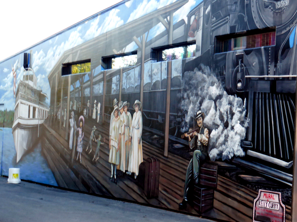 mural depicting early forms of transportation for vacationers, Clayton, New York