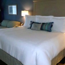 guest room bed, Chautauqua Harbor Hotel, Celoron, NY