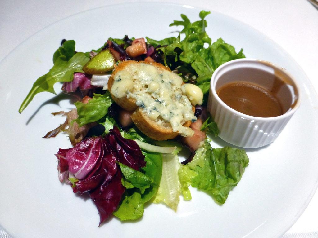 Apple, pear and cucumber salad, frisée, dried cherries, blue cheese croûton at the Gala Dinner, Eurodam