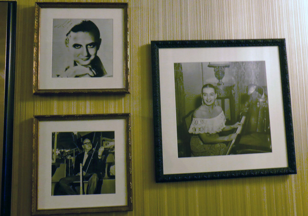 photographs of Guy Lombardo (upper left), Jack Benny (lower left) and Be a Morin (right), from a family who played the lobby's grand piano for many years.